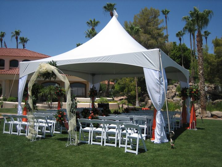 Tent wedding ceremony with seating for 60