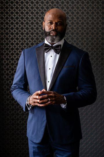 A classy groom in blue