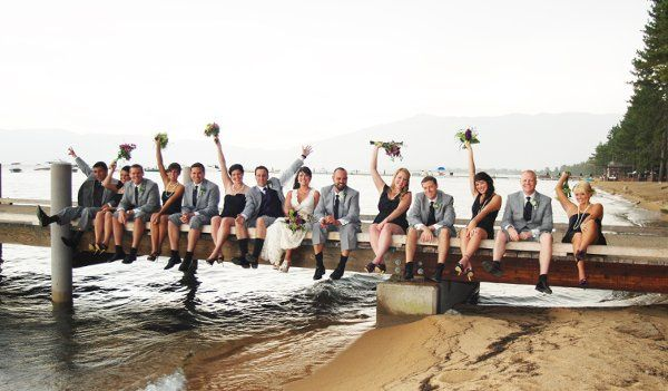 Newlyweds, bridesmaids, and groomsmen on the boardwalk