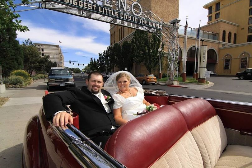 Bride and groom in their wedding car