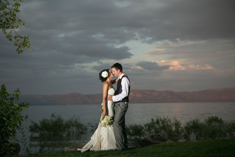 Newlyweds kissing with a view