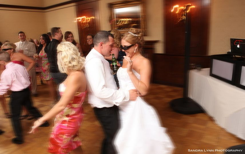 Couple with guest dancing