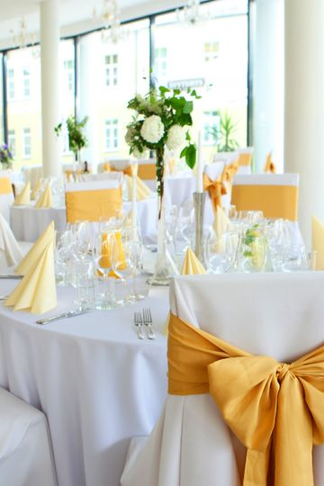 Add a pop of color by adding chair sashes and napkins in a bold color.