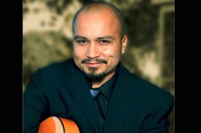 Spanish Latin Acoustic Guitarist www.ricoespinoza.com