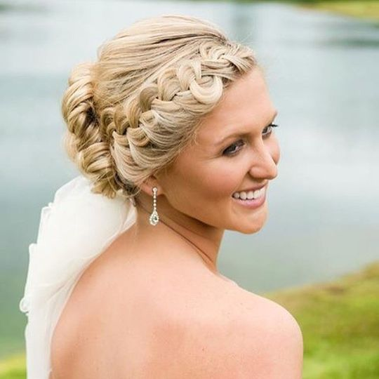 Braided hair tied into an updo