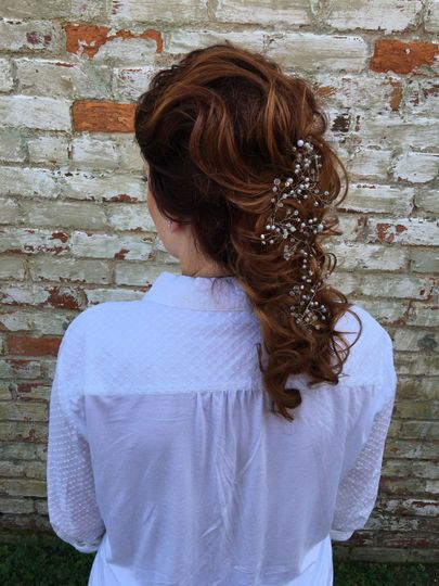 Braided hair with baby's breath flowers