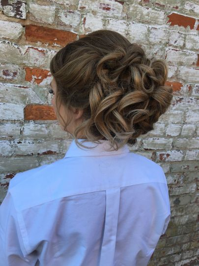 Curly hair tied into an updo