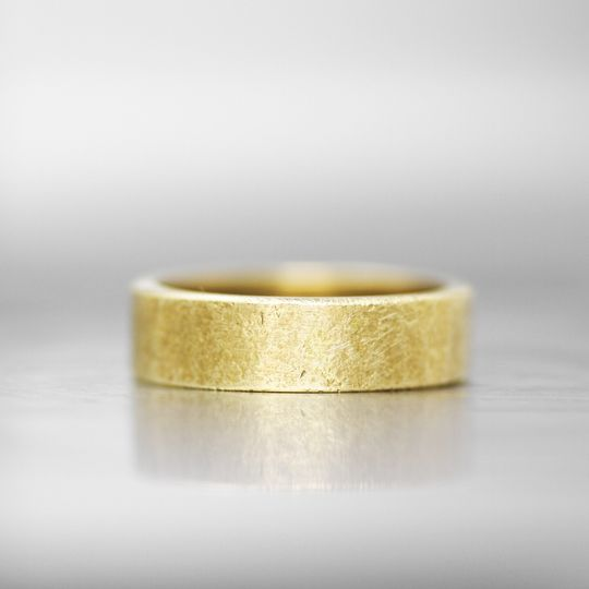 MANCHESTER  This timeless wedding band brings an element of class and comfort. The signature...