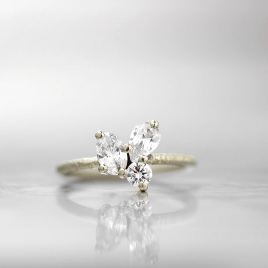 VALENCIAA unique combination of diamond shapes in a clustered prong setting, this engagement ring...