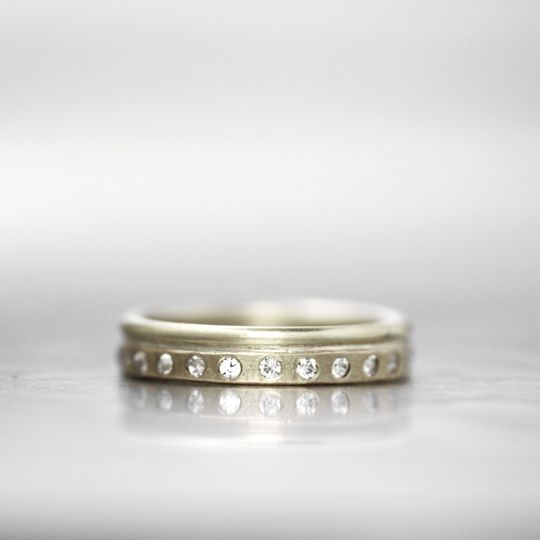 OSTERLING  This unique diamond wedding band creates dimension with the opposing rounded and squared...