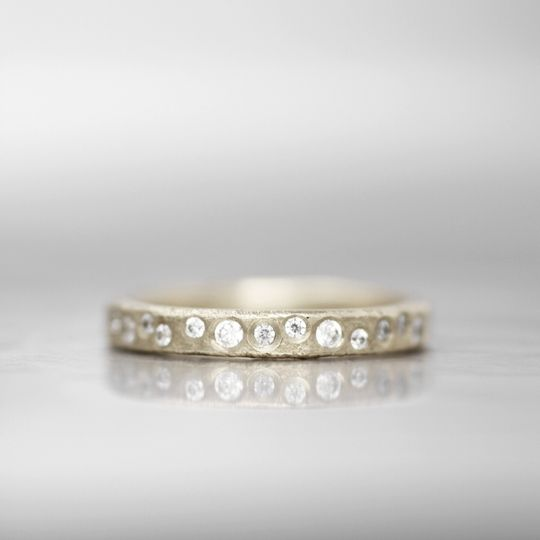 VERMILLION  This timeless diamond wedding band brings an element of class and comfort. The signature...
