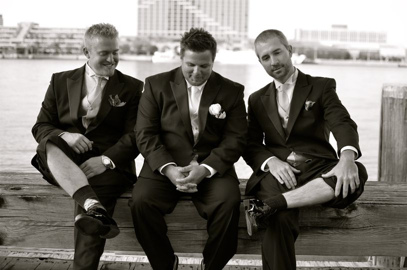 Groom Chris with his mates acting the goat down by the waterside on the St. John's river.