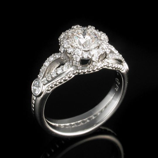 Brilliant cathedral engagement ring