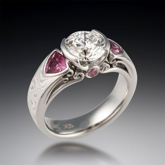 Modern falling water engagement ring