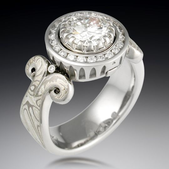 Carved curls engagement ring