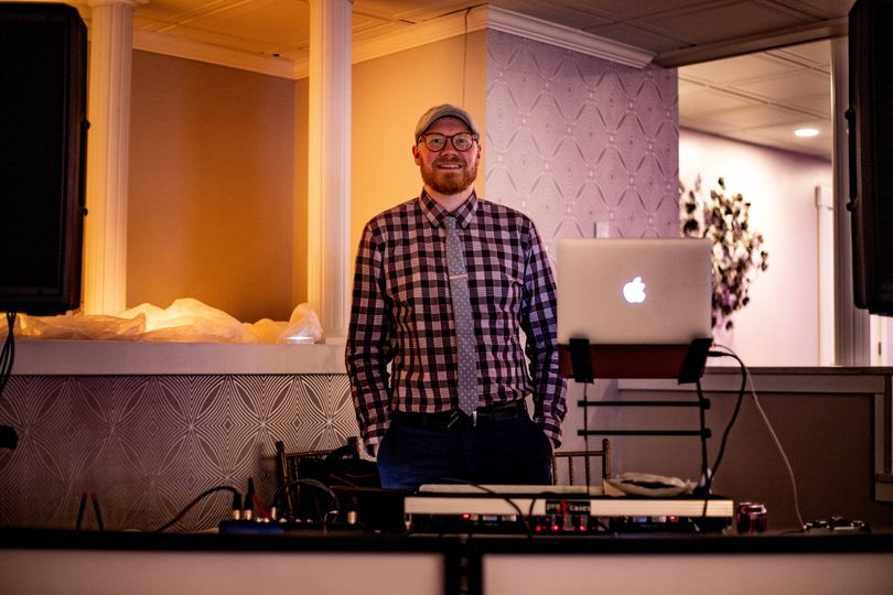 DJ Adam Robb at the booth