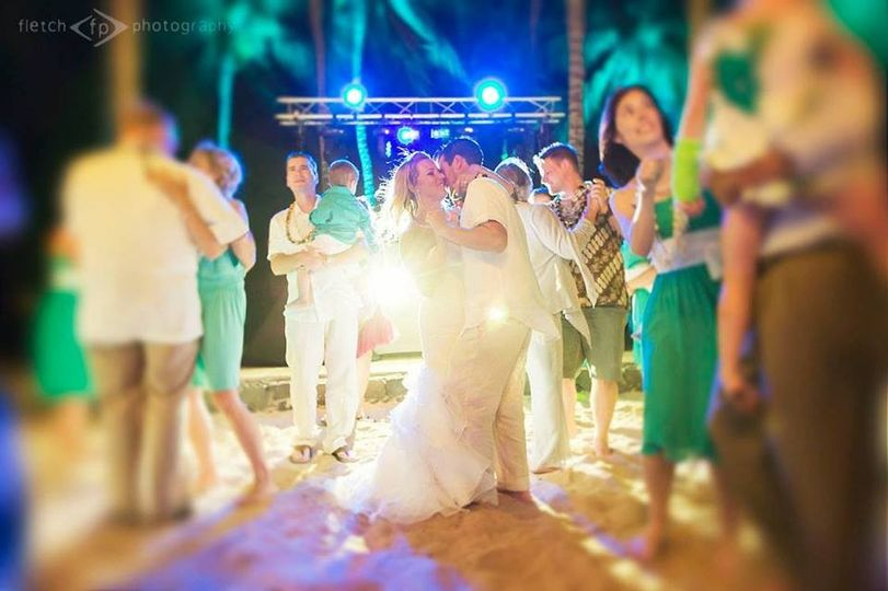 Newlyweds and guests dancing