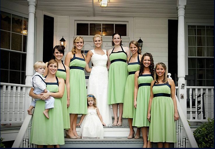 Bride, bridesmaids, and flower girl by the steps