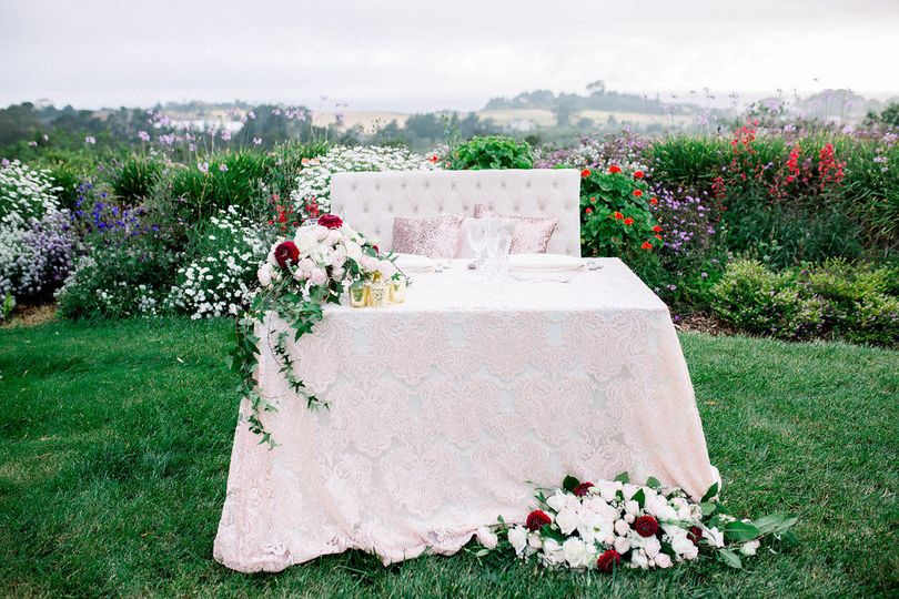 Romantic sweetheart table with love seat