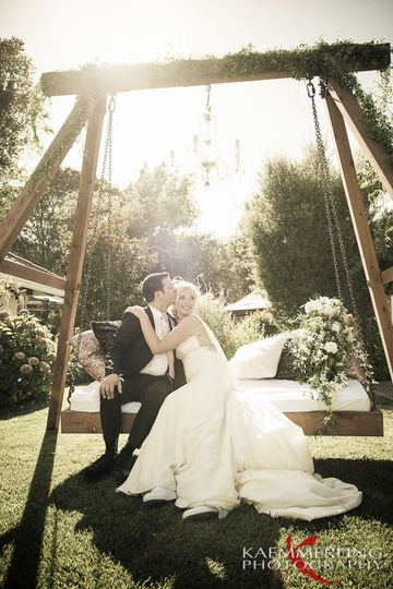 Love seat swing and chandelier out door wedding reception