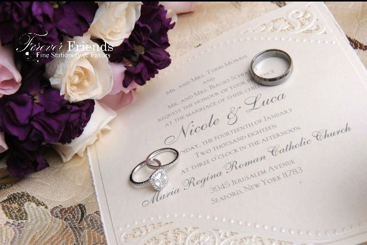 Nicole and Luca's ecru shimmer pearls and laser cut lace wedding invitation