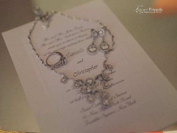 Danielle and Christopher's bright white wedding invitation