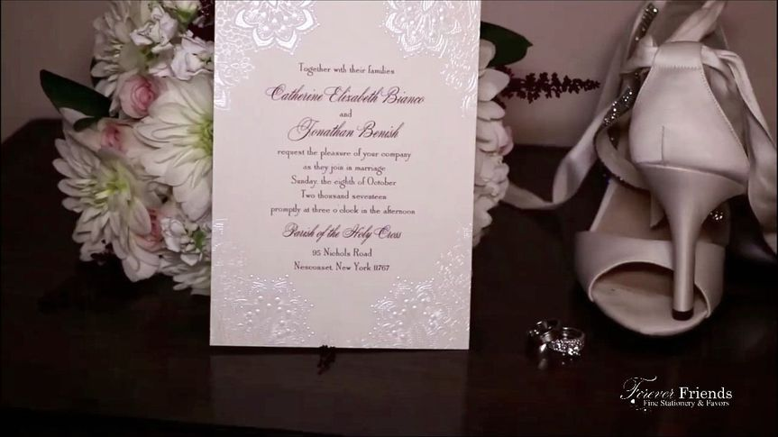 Catherine and Jonathan's shimmering pearl foil lace wedding invitation