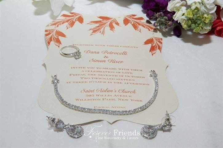 Dana and Simon's crest shape leafs wedding invitation gives a natural elegance to this ecru shimmer...