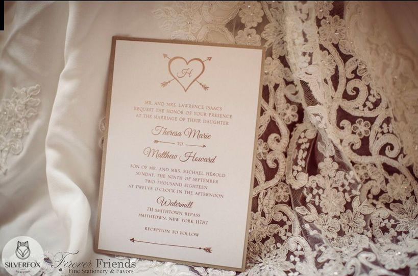Theresa and Matthew's rose gold foil hearts and arrows wedding invitation
