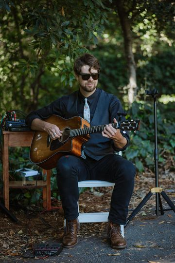 Zeb with Sounds Elevated providing acoustic guitar for a ceremony at Cal Faculty Club in Berkeley,...