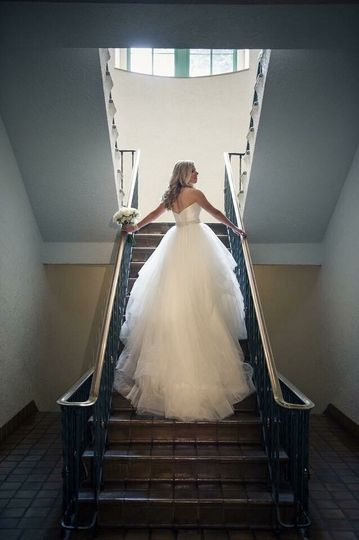 The bride going down the stairs