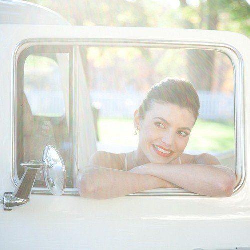 Bride by the car window