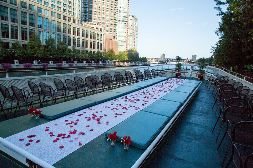 Open air upper deck set up for ceremony with aisle runner atop raised skylight of Chicago's First...