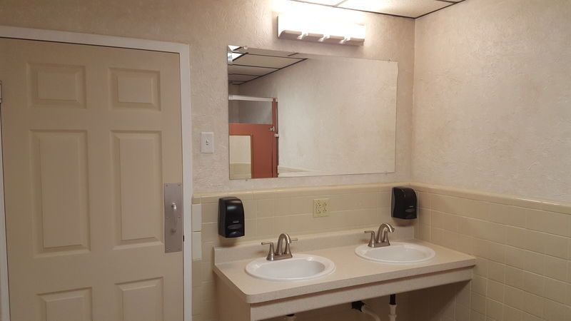 Updated restroom featuring LED lighting
