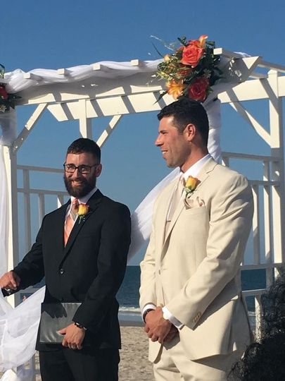 Officiant chatting with the groom