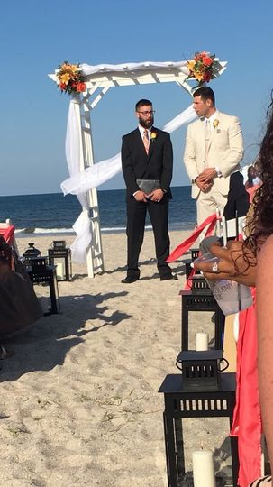 Officiant and groom waiting for the bride