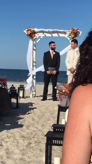 Wedding officiant and groom