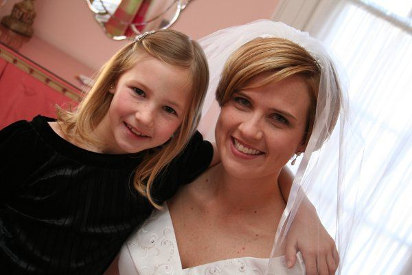 Bride and flower girl before wedding.