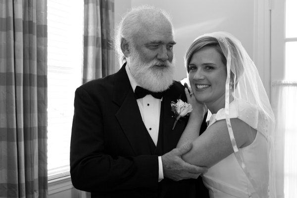 Bride with her father before wedding.