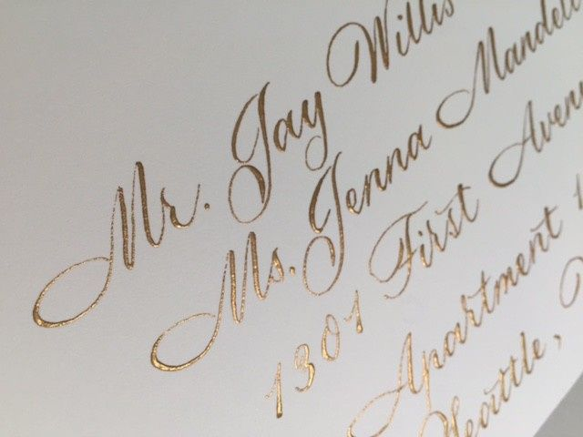 Traditional calligraphy and gold ink for wedding invitation envelopes.