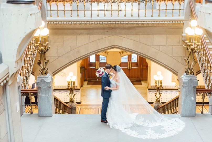 Newlyweds by the staircase