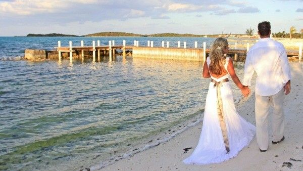 bahamas beach wedding couple walkin