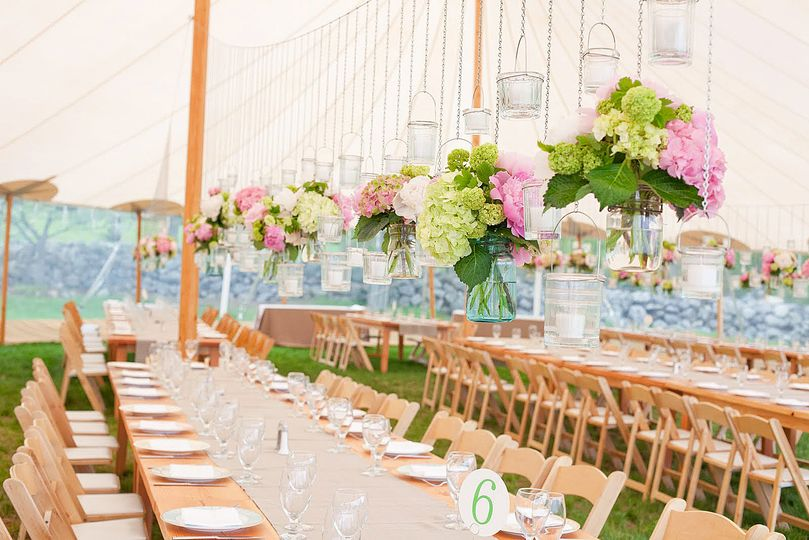 Long tables and hanging floral decor