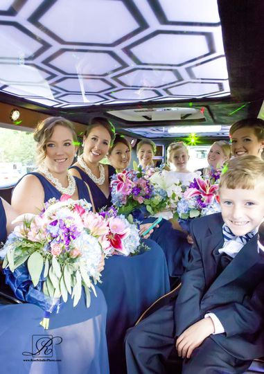 Bridesmaids inside the limo