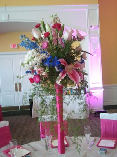 "Centerpiece on top of 24"" tower vase wrapped with pink satin ribbon.  Tower vase is rental item from..."