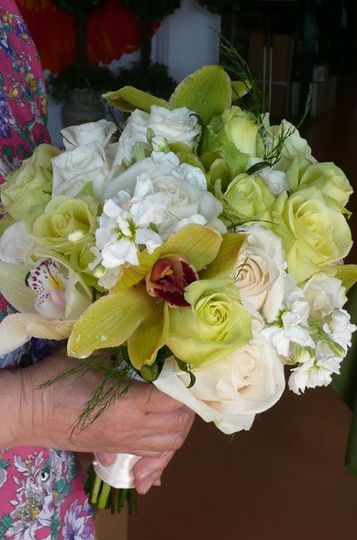 Bridal bouquet of green roses and cymbidium orchids, white stock and creamy white roses