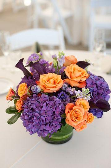 Purple hydrangea and orange roses