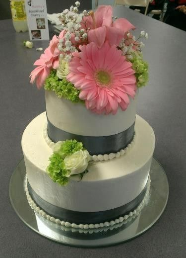 Two tier cake with pink flowers