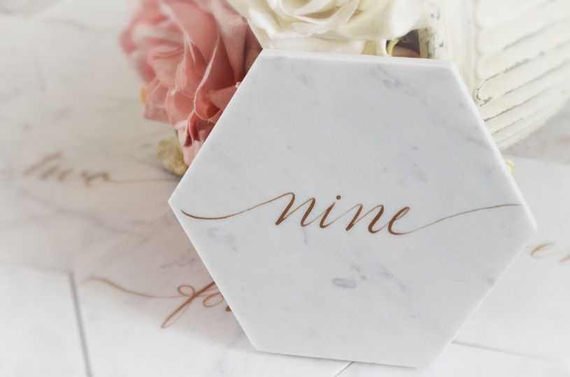white marble tile table numbers houston calligraph
