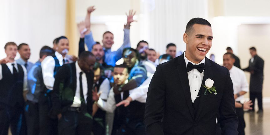 Photograph of the groom laughing after he threw the garter to all the single men at his wedding....
